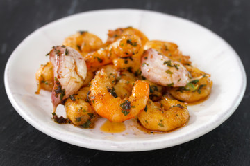shrimps with garlic and herbs on plate