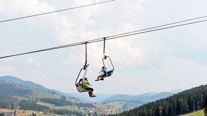 mountain lift with tourists moves in Carpathians, closeup
