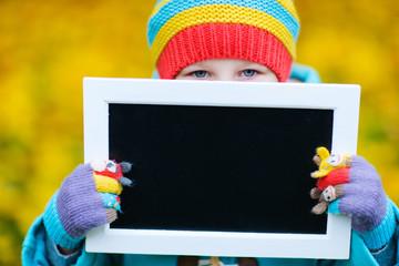 Little girl outdoors on autumn day