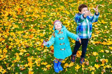 Little kids outdoors in autumn park