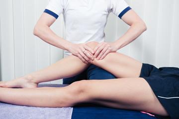 Physiotherapist treating knee