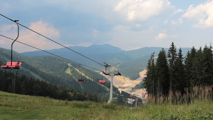 empty mountain lift moves up and down Carpathian Mountains