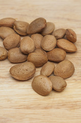 Some almonds in wooden background