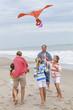 Family Parents Girl Children Flying Kite on Beach
