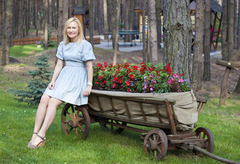 Ukrainian Woman sitting on a cart and looking straight