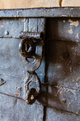 Closeup on the locks of an old metal chest
