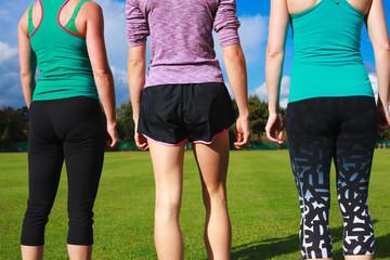Three women wearing sportswear in the park