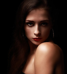 Sexy woman looking on dark black background