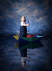 Little girl sailing using the umbrella