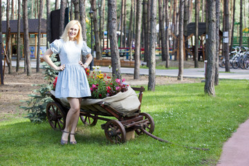 Ukrainian blonde girl sitting on a cart