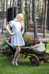 Ukrainian blonde girl sitting on a cart