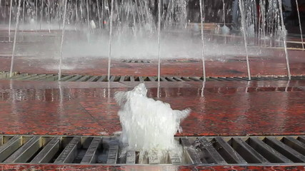 closeup of water in beautiful big fountain at city center