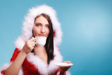 Portrait woman wearing santa claus costume