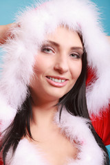 Portrait woman wearing santa claus costume on blue