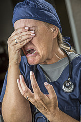 Agonizing Crying Female Doctor or Nurse