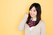 young asian woman on yellow background