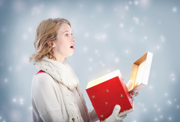 Happy Young Woman Overjoyed After Opening a Big Red Gift