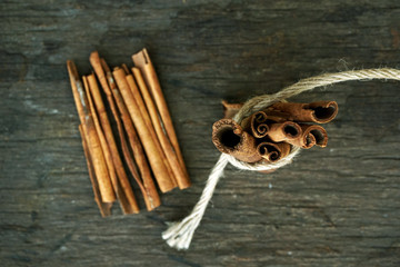 Cinnamon sticks on wooden background