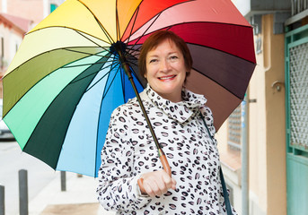 mature woman with umbrella