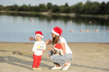 little Santa with mother on the river bank! Merry Christmas