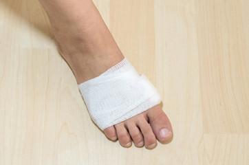 White medicine bandage on injury foot