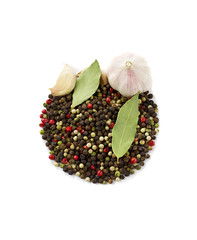 Spices: garlic, peppercorns, bay leaf  isolated on a white
