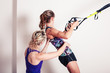 Постер, плакат: Athletic woman and personal trainer