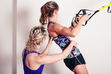 Athletic woman and personal trainer