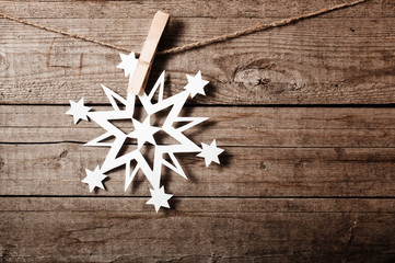 Snowflakes border on grunge wooden background