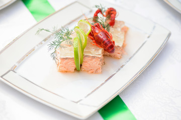 Fish dish and crayfish on the festive table
