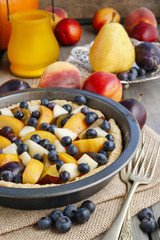 Tart with peach, pumpkin, plum, pear and blueberry