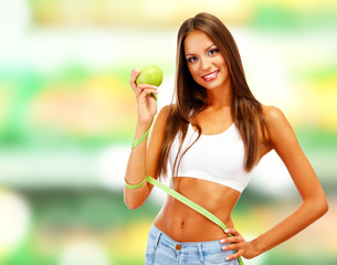 Shopping concept. Beautiful young woman with green apples and