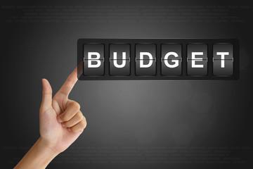 hand pushing financial budget on Flip Board