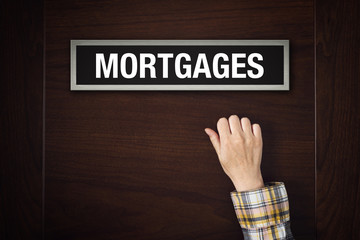 Hand is knocking on Mortgages door