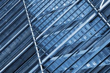 Modern metal scaffolding on wall, blue toned
