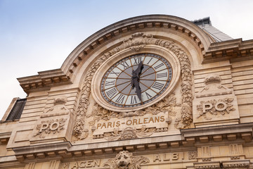 Ancient clock on the wall of Orsay Museum in Paris
