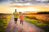 Fototapety Couple running at sunset