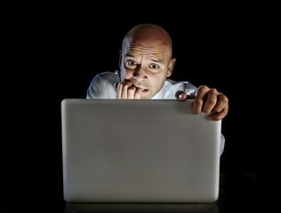 Addict man at computer watching porn internet addiction concept