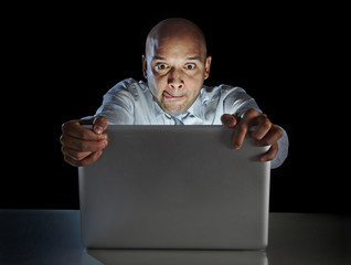 Addict man at laptop watching porn internet addiction concept