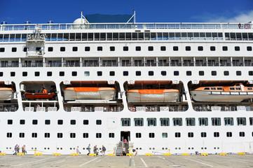 Cruise ship in port, passenger boarding