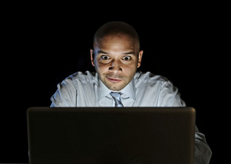 addict businessman at computer watching porn or online gambling