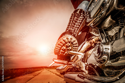 canvas print picture Biker girl riding on a motorcycle