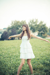 beautiful young woman with white dress
