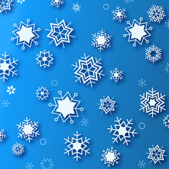 Wintertime - blue background with white beautiful snowflakes