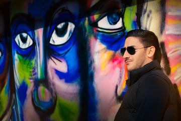 Young Man Standing Near Graffiti Wall