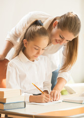 mother helping daughter with preparing to exam