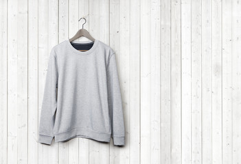 Sweater on a white wood wall