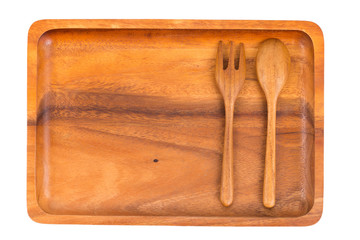 Wooden plate with spoon and fork isolated on white background