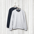 canvas print picture - Sweaters on a white wood wall