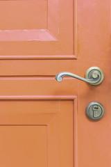 classic door handle on red door